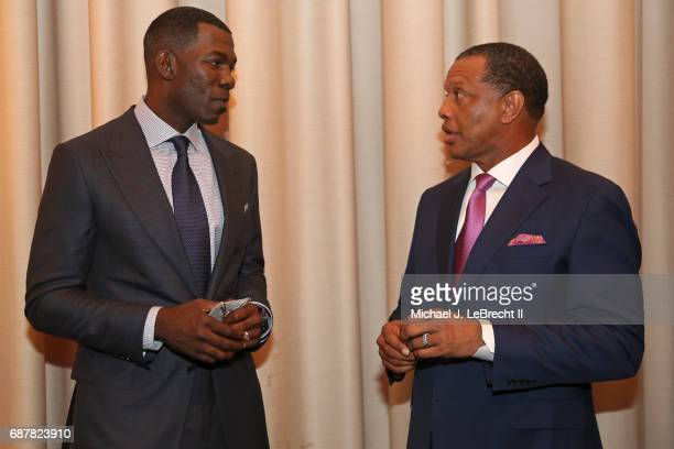 Michael Finley of the Dallas Mavericks talks with Alvin Gentry of the New Orleans Pelicans during the 2017 NBA Draft Lottery at the New York Hilton...