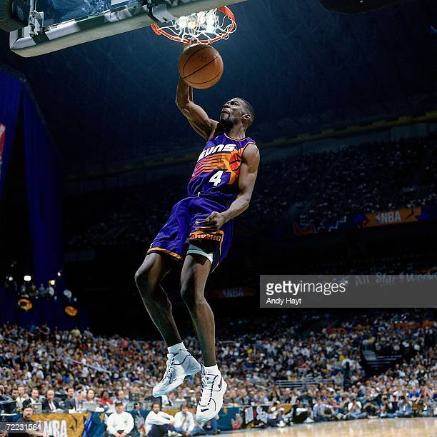 Michael Finley of the Phoenix Suns attempts a dunk during the 1996 Slam Dunk Contest on February 10 1996 at the Alamodome in San Antonio Texas NOTE...