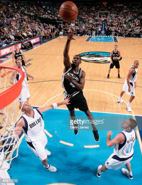 Michael Finley of the San Antonio shoots in the lane against the Dallas Mavericks on December 9 2008 at the American Airlines Center in Dallas Texas...