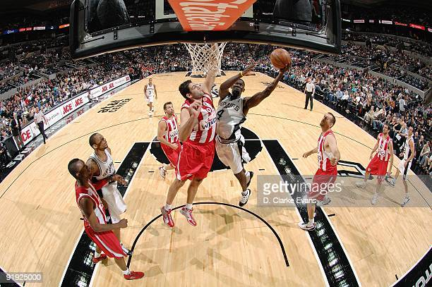 Michael Finley of the San Antonio Spurs lays up a shot against Ioannis Bourousis of the Greece Olympiacos during the exhibition game on October 9...