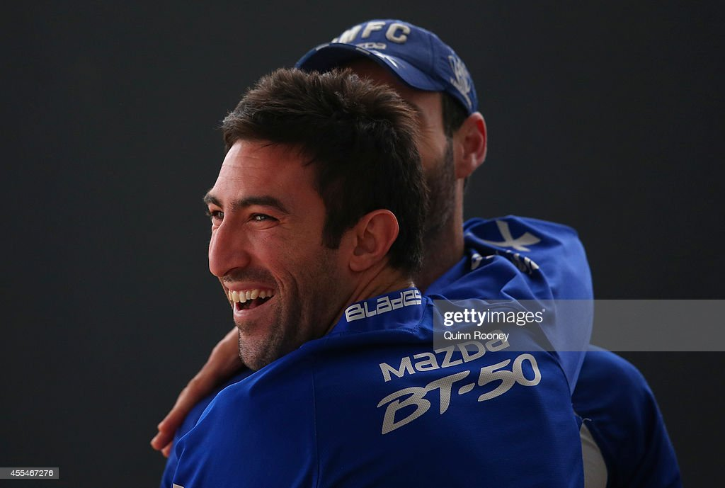 Michael Firrito of the Kangaroos has a laugh during a North Melbourne Kangaroos AFL training session at Arden Street Ground on September 15, 2014 in Melbourne, Australia.