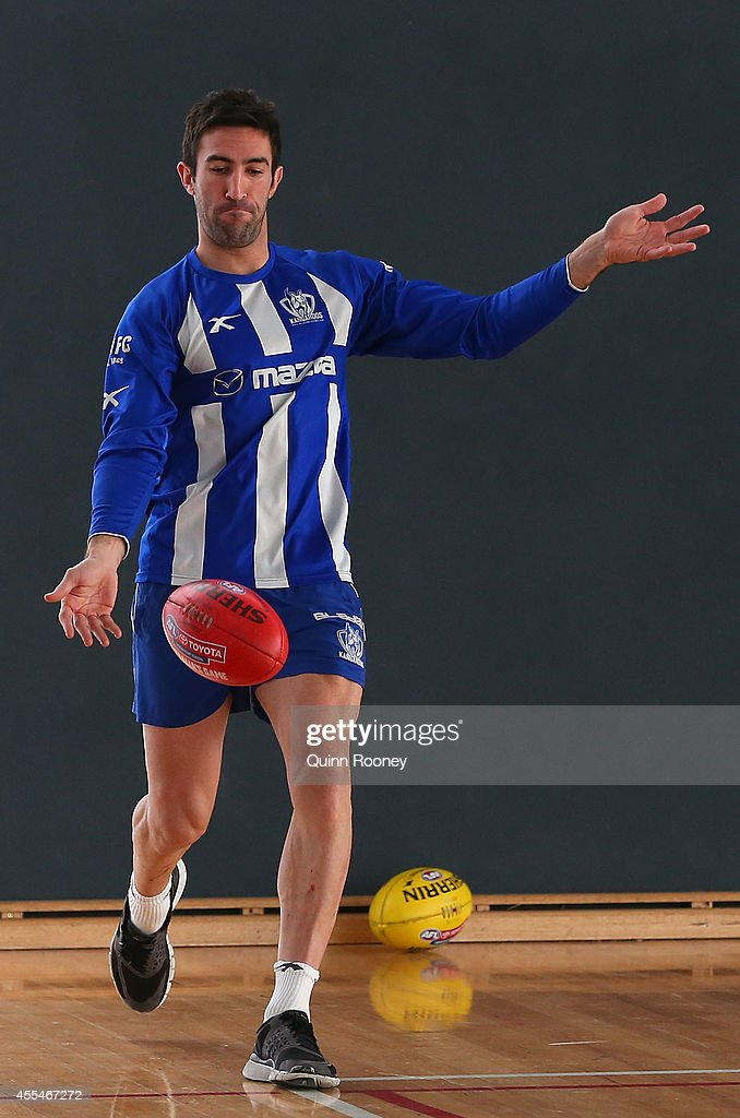 Michael Firrito of the Kangaroos kicks during a North Melbourne Kangaroos AFL training session at Arden Street Ground on September 15, 2014 in Melbourne, Australia.
