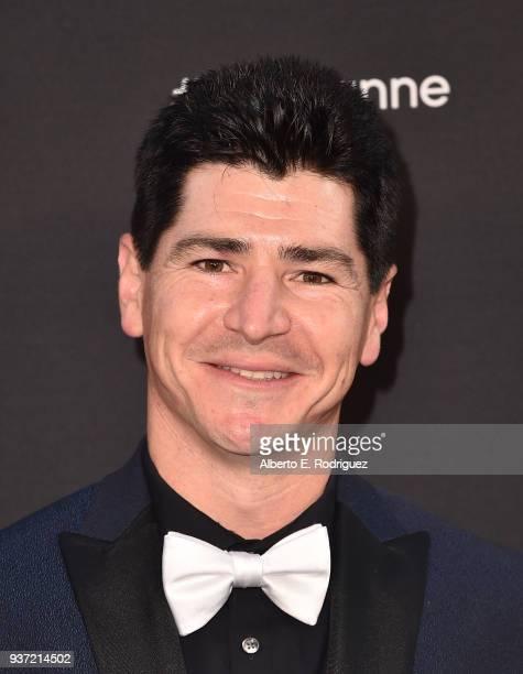 Michael Fishman attends the premiere of ABC's Roseanne at Walt Disney Studio Lot on March 23 2018 in Burbank California