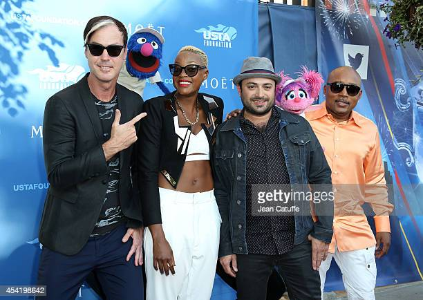 Michael Fitzpatrick, Grover, Noelle Scaggs, James King, Abby Cadabby and Daymond John attend the 2014 US Open's 14th Annual USTA Opening Night Gala...