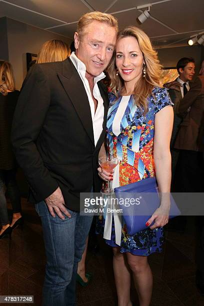 Michael Flatley and Nathalie Lambert arrive at the Private View of 'Firedance' the inaugural art exhibition of artist Michael Flatley at 12 Hay Hill...