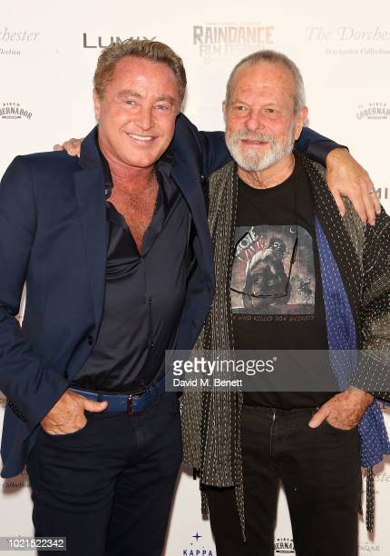 Michael Flatley and Terry Gilliam attend the Raindance VIP Party at The Dorchester on August 22 2018 in London England