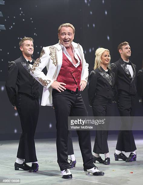 Michael Flatley with James Keegan and the cast onstage during the curtain call for the Broadway Opening and dedut of 'Lord of the Dance Dangerous...
