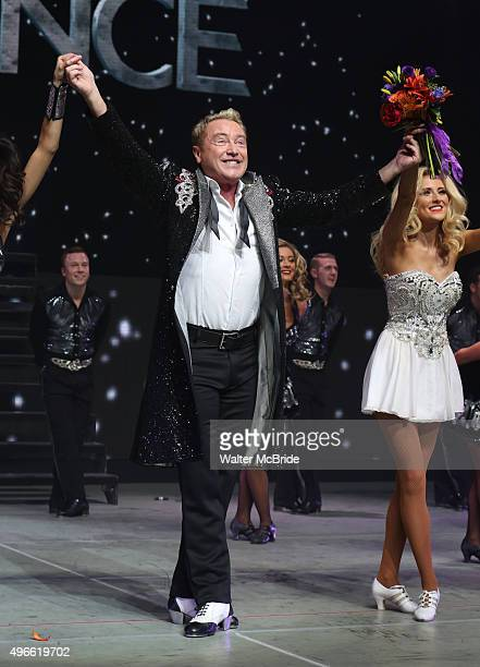 Michael Flatley with the cast onstage during the curtain call for the Broadway Opening and dedut of 'Lord of the Dance Dangerous Games' at The Lyric...