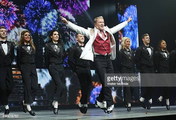 Michael Flatley with the cast onstage during the curtain call for the Broadway Opening and debut of 'Lord of the Dance Dangerous Games' at The Lyric...