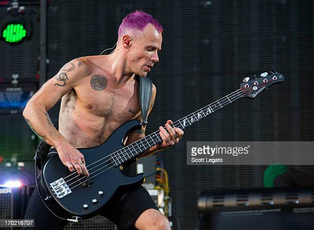 Michael Flea Balzary of Red Hot Chili Peppers performs during the 2013 Orion Music More Festival at Belle Isle Park on June 8 2013 in Detroit Michigan