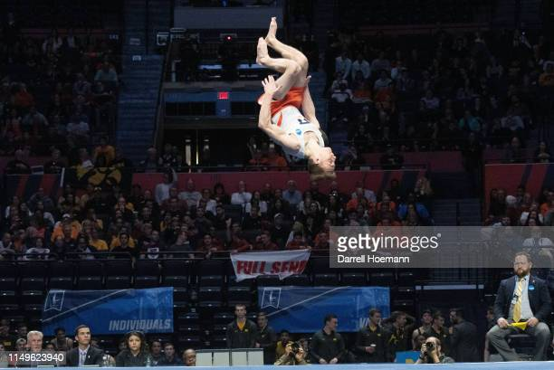 Michael Fletcher of the Illinois Fighting Illini competes in floor exercises during the Division I Men's Gymnastics Championship held at the State...