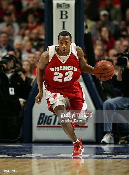 Michael Flowers of the Wisconsin Badgers brings the ball up court against the Ohio State Buckeyes during the Final of the Big Ten Men's Basketball...