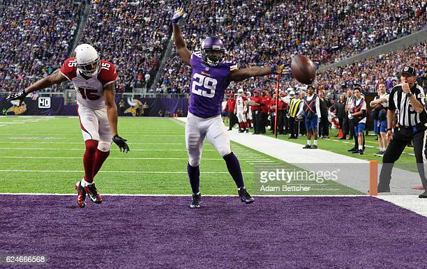 Michael Floyd of the Arizona Cardinals and Xavier Rhodes of the Minnesota Vikings watch a passed ball fall in the end zone during the second half of...