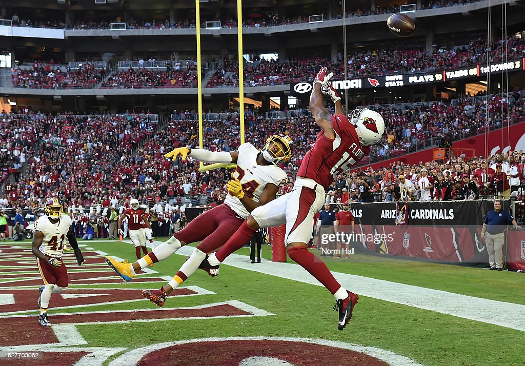 Michael Floyd #15 of the Arizona Cardinals cannot make a leaping catch in the endzone while being defended by Josh Norman #24 of the Washington Redskins during the second quarter at University of Phoenix Stadium on December 4, 2016 in Glendale, Arizona.