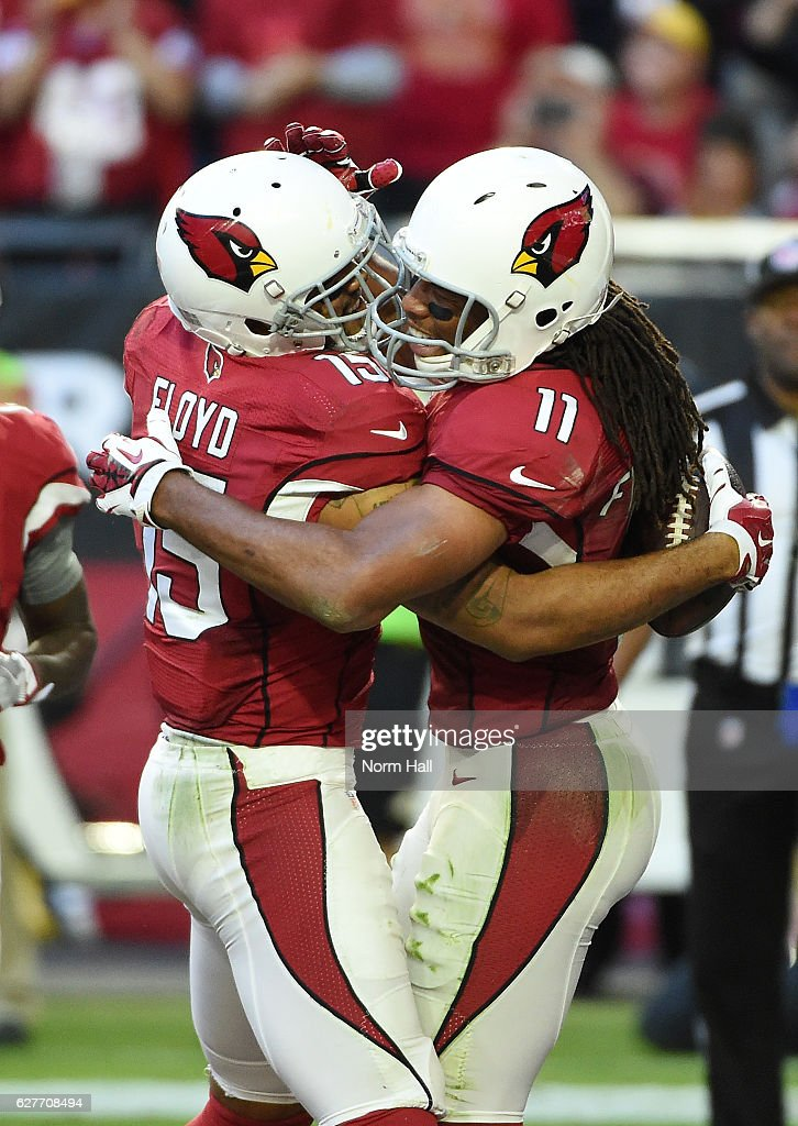 Michael Floyd #15 of the Arizona Cardinals celebrates a touchdown with teammate Larry Fitzgerald #11 during the third quarter against the Washington Redskins at University of Phoenix Stadium on December 4, 2016 in Glendale, Arizona. Cardinals won 31-23.