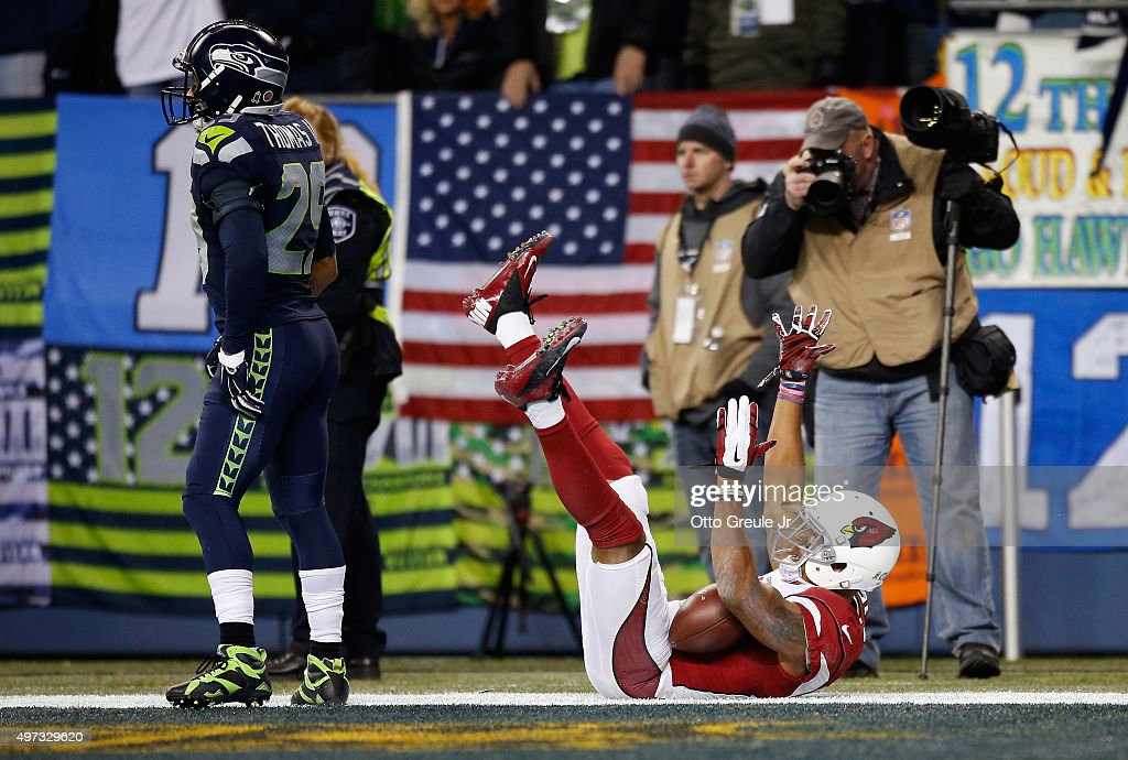 Michael Floyd #15 of the Arizona Cardinals celebrates scoring a touchdown during the second quarter as Earl Thomas #29 of the Seattle Seahawks looks on at CenturyLink Field on November 15, 2015 in Seattle, Washington.
