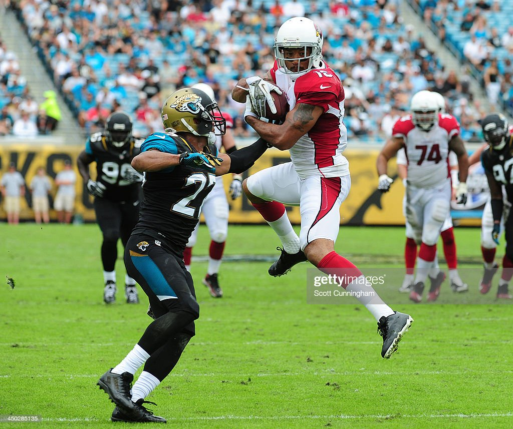 Michael Floyd #15 of the Arizona Cardinals makes a catch against Dwayne Getz #27 of the Jacksonville Jaguars at EverBank Field on November 17, 2013 in Jacksonville, Florida.
