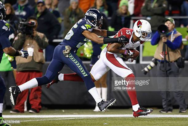 Michael Floyd of the Arizona Cardinals makes a touchdown reception during the second quarter as Cary Williams of the Seattle Seahawks defends at...