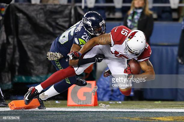Michael Floyd of the Arizona Cardinals scores a touchdown during the second quarter as Cary Williams of the Seattle Seahawks defends at CenturyLink...