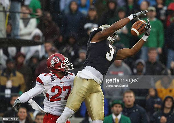 Michael Floyd of the Notre Dame Fighting Irish catches a touchdown pass over Brandon Burton of the Utah Utes at Notre Dame Stadium on November 13,...
