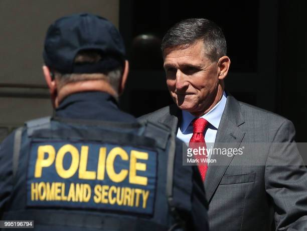 Michael Flynn former national security advisor to US President Donald Trump walks out of the E Barrett Prettyman Federal Courthouse after a status...