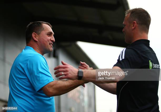 Michael Flynn of Newport County AFC and Barnet FC Manager Martin Allen shake hands ahead of the Sky Bet League Two match between Barnet FC and...