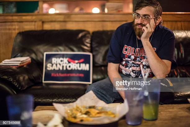 Michael Frank a supporter of Republican presidential candidate Rick Santorum from Martinsburg West Virginia watches the GOP presidential debate at...