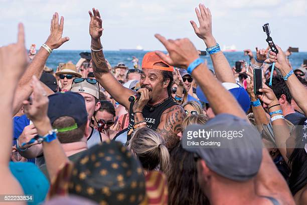 Michael Franti of Michael Franti Spearhead performs in the crowd on April 17 2016 in Fort Lauderdale Florida