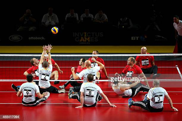 Michael Frenzke of Germany competes in the Sitting Volleyball 5th/6th Place Playoff between Denmark and Germany at the Copper Box Arena on day four...
