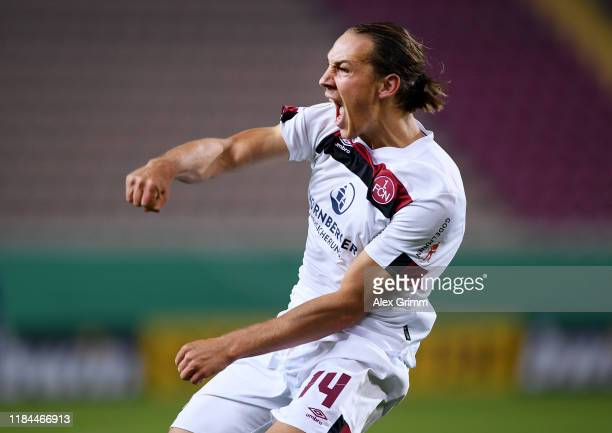 Michael Frey of 1. FC Nuernberg celebrates after scoring his team's second goal during the DFB Cup second round match between 1. FC Kaiserslautern...