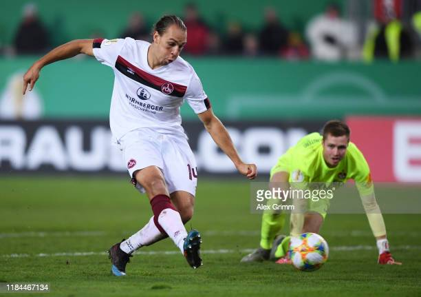Michael Frey of 1. FC Nuernberg scores his team's second goal during the DFB Cup second round match between 1. FC Kaiserslautern and 1. FC Nuernberg...