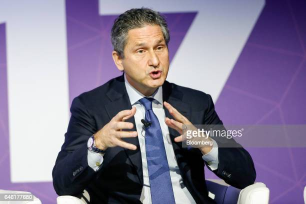 Michael Fries, chief executive officer of Liberty Global Plc, gestures while speaking on the second day of Mobile World Congress in Barcelona, Spain,...