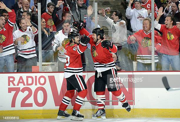 Michael Frolik and Brent Seabrook of the Chicago Blackhawks celebrate after Frolik scored against the Phoenix Coyotes during Game Three of the...