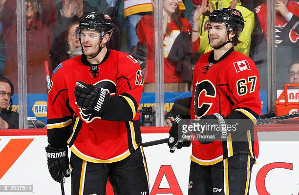 Michael Frolik and Lance Bouma of the Calgary Flames celebrate after a goal against the St Louis Blues at Scotiabank Saddledome on March 14 2016 in...