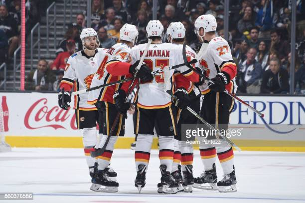 Michael Frolik Matt Bartkowski Sean Monahan Matthew Tkachuk and Dougie Hamilton of the Calgary Flames celebrate a goal during a game against the Los...