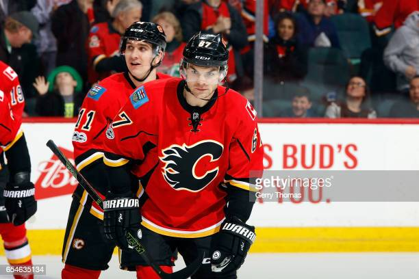 Michael Frolik Mikael Backlund and teammates of the Calgary Flames celebrate a goal agianst the Dallas Stars during an NHL game on March 17 2017 at...