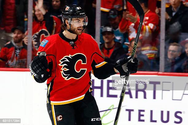 Michael Frolik of the Calgary Flames celebrates a goal against the San Jose Sharks during an NHL game on January 11 2017 at the Scotiabank Saddledome...