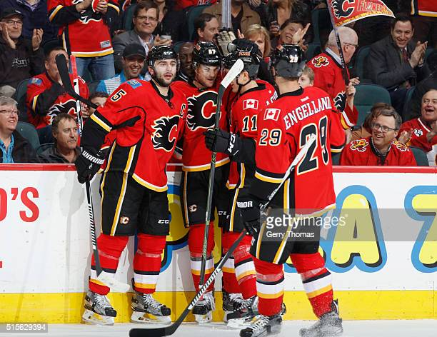 Michael Frolik of the Calgary Flames celebrates with teammates after scoring a short handed goal against the St Louis Blues at Scotiabank Saddledome...