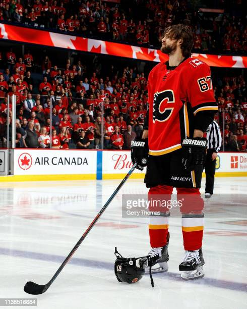 Michael Frolik of the Calgary Flames stands for the national anthems before the start of an NHL game where the Calgary Flames hosted the Los Angeles...