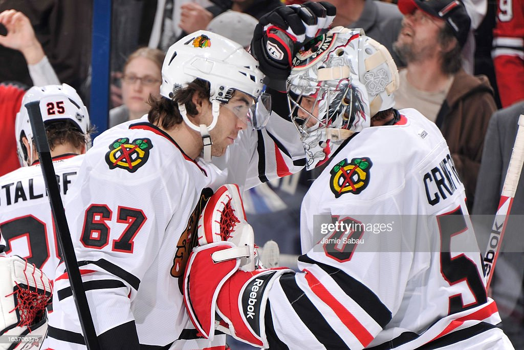 Michael Frolik #67 of the Chicago Blackhawks celebrates a 2-1 shootout win against the Columbus Blue Jackets with goaltender Corey Crawford #50 of the Chicago Blackhawks on March 14, 2013 at Nationwide Arena in Columbus, Ohio.