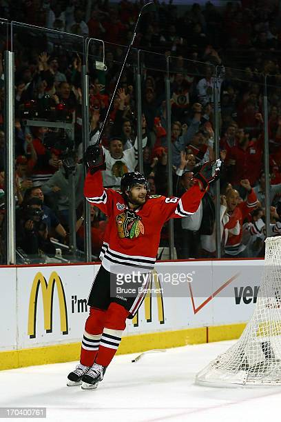 Michael Frolik of the Chicago Blackhawks celebrates after teammate Johnny Oduya scored a goal in the third period against the Boston Bruins in Game...