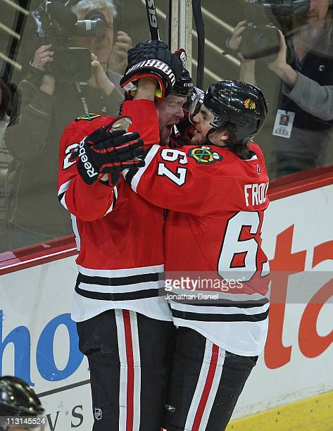 Michael Frolik of the Chicago Blackhawks hugs teammate Bryan Bickell after Bickells' 1st period goal against the Vancouver Canucks in Game Six of the...