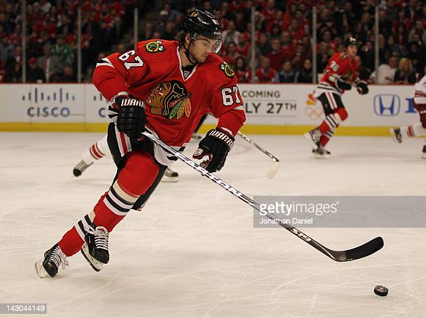 Michael Frolik of the Chicago Blackhawks moves up the ice against the Phoenix Coyotes in Game Three of the Western Conference Quarterfinals during...