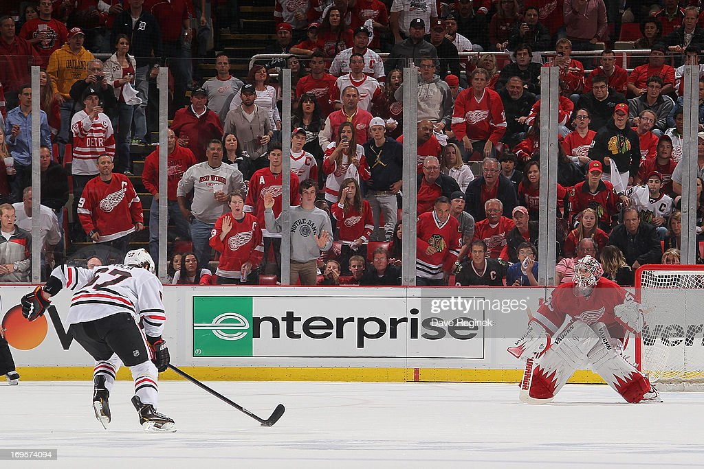 Michael Frolik #67 of the Chicago Blackhawks skates in for a penalty shot attempt on Jimmy Howard #35 of the Detroit Red Wings during Game Six of the Western Conference Semifinals during the 2013 NHL Stanley Cup Playoffs at Joe Louis Arena on May 27, 2013 in Detroit, Michigan. Chicago won 4-2