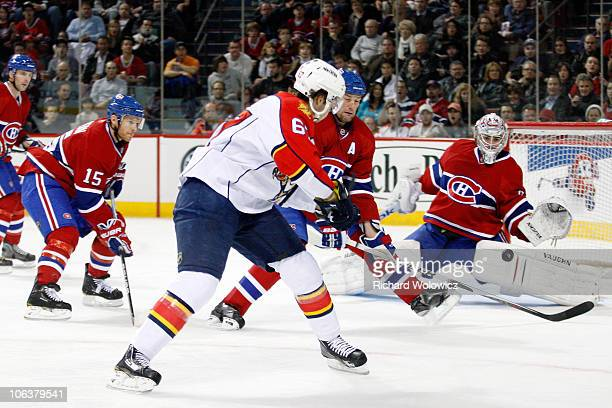 Michael Frolik of the Florida Panthers scores a goal on Carey Price of the Montreal Canadiens during the NHL game at the Bell Centre on October 30...