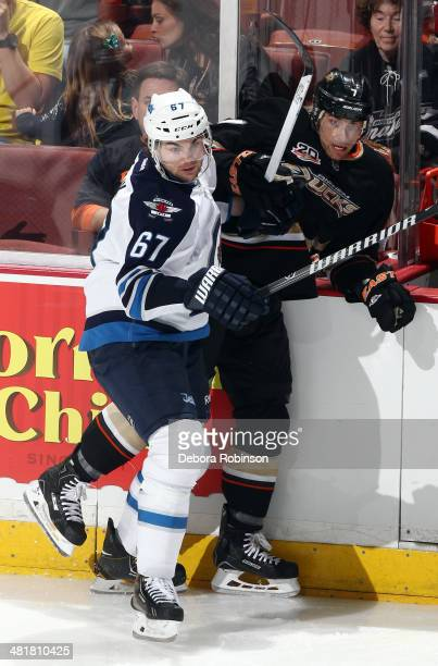 Michael Frolik of the Winnipeg Jets battles for position against Andrew Cogliano of the Anaheim Ducks on March 31 2014 at Honda Center in Anaheim...