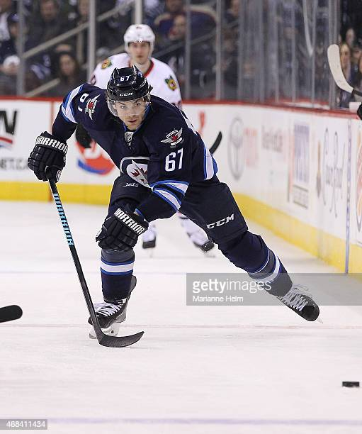 Michael Frolik of the Winnipeg Jets skates down the ice in second period action in an NHL game against the Chicago Blackhawks at the MTS Centre on...