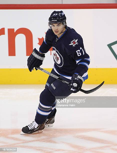 Michael Frolik of the Winnipeg Jets warms up before an NHL game against the Detroit Red Wings at the MTS Centre on November 4 2013 in Winnipeg...