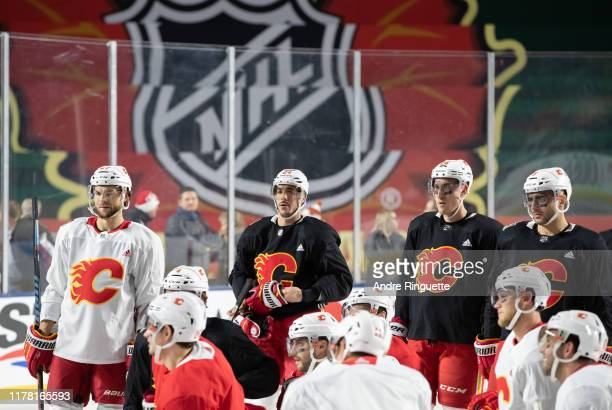 Michael Frolik, Travis Hamonic, Michael Stone and Mark Giordano of the Calgary Flames look on during practice in advance of the 2019 Tim Hortons NHL...