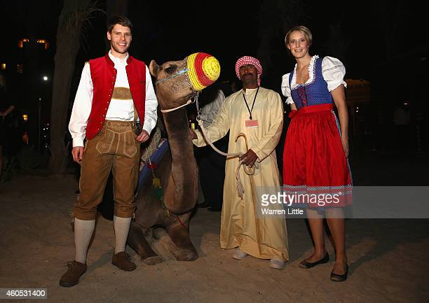 Michael Fuchs and Birgit Michels of Germany pose with a camel during the gala dinner for the BWF Destination Dubai World Superseries Finals at the...